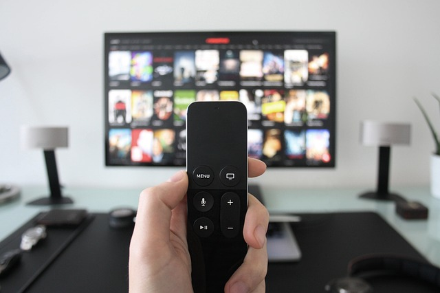 Apple TV remote in hand
